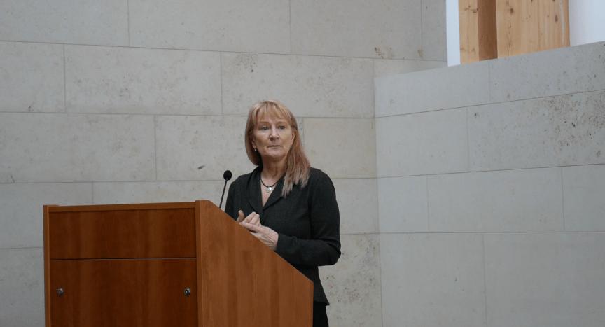 image of Professor Marina Jirotka standing at a podium